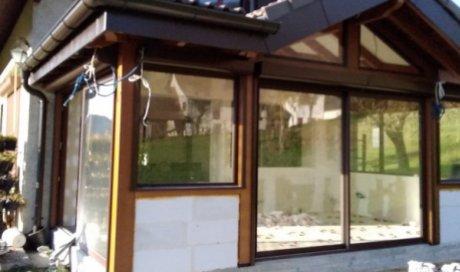 Création d'une véranda sur dalle béton avec du carrelage en 60x60 sur Novalaise